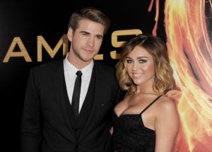 Miley Cyrus e Liam Hemsworth | © Kevin Winter/Getty Images