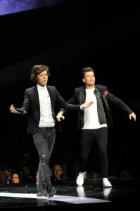 Harry Styles and Louis Tomlinson of One Direction | © Matt Kent / Getty Images