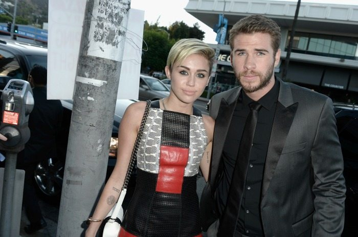 Miley Cyrus e Liam Hemsworth   © Kevin Winter / Getty Images